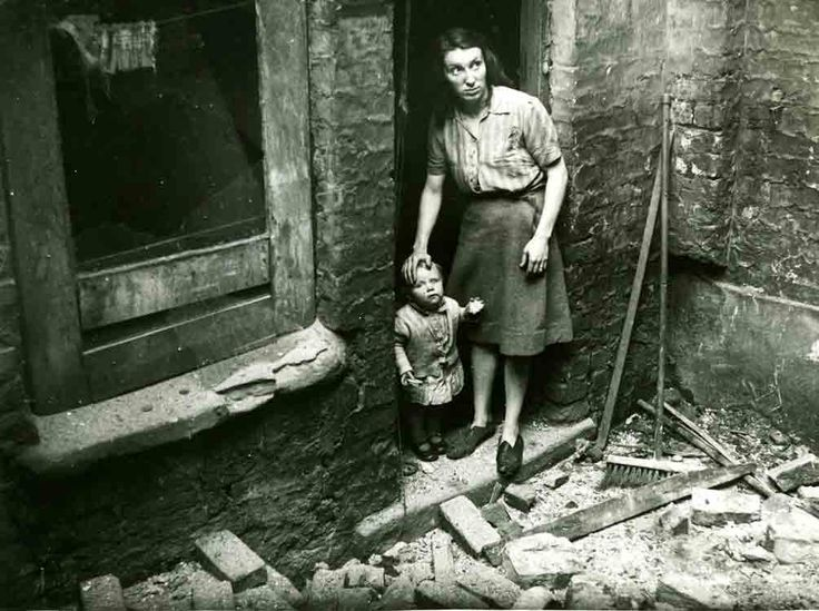Housing being demolished while people are still living in them, Liverpool, 1946