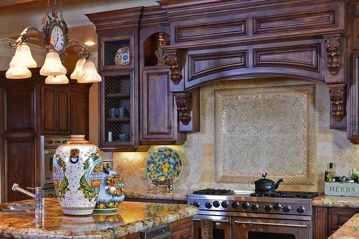 Mediterranean Kitchen with Durango Travertine, Oregon Tile & Marble, Complex granite counters, Glass panel, Undermount Sink