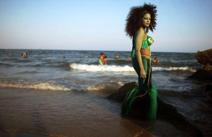 A reveler dressed as a mermaid poses for a photo at the annual Coney Island Mermaid Parade June 21, 2008 in the Brooklyn borough of New York City.(Mario Tama, Getty Images)