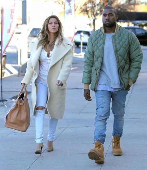 Couple Kim Kardashian and Kanye West out doing some shopping at a sporting goods store in Los Angeles, California on December 26, 2013. Kim ...