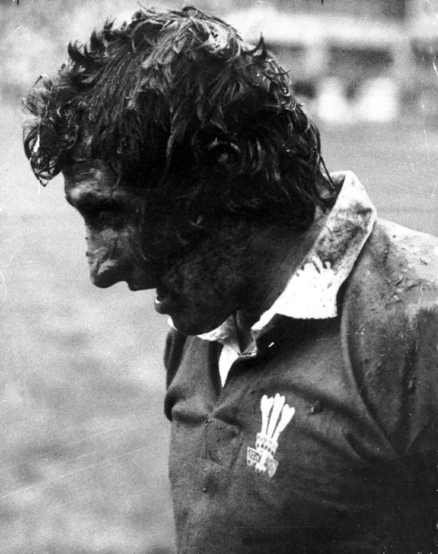 The famous picture of Gareth Edwards in the Arms Park mud after his two tries earned victory against Scotland in 1972