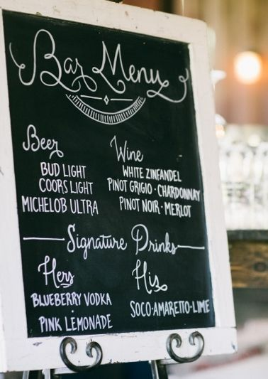Cut costs by not offering a full bar--have a basic selection of wine and beer + signature drinks. (A full bar doesn't seem appropriate for a backyard barbecue anyway.) Also like the chalkboard menu.