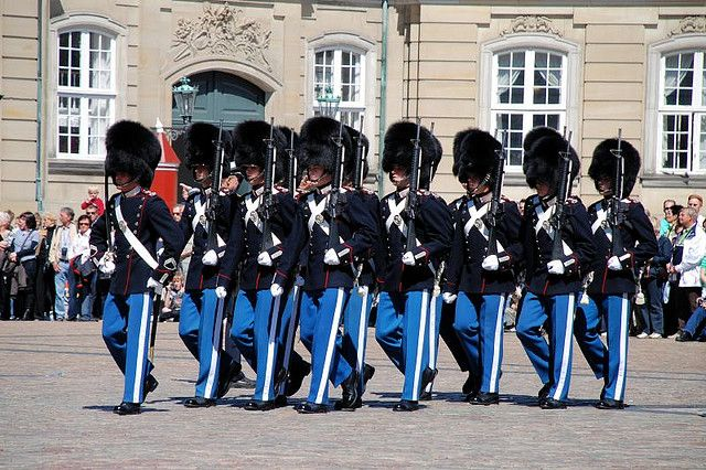 Changing of the Guard    Change of the Royal Guard in front of Amalienborg Palace, the residence of the Danish Queen. The ceremony takes place every day at noon.