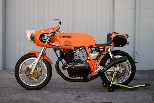Ah, Laverda. The great, lost name of motorcycling. KTM now has a mortgage on vibrant orange motorcycles, but in the 70s the color was synonymous with the Breganze factory in northern Italy. Few builders get the chance to work on Laverdas these days, but Takashi Iwamoto of Cascade Cafe Racer in Hawthorne, California is one…