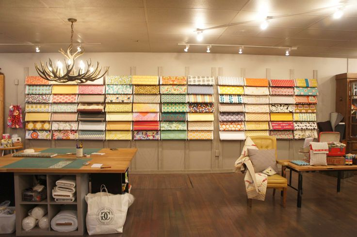 Www Fabricnosherie Com A Beautiful Fabric Store That Is Sadly Closing Love Their Layout And Fabric Display Retail Store Decor Fabric Display Fabric Store