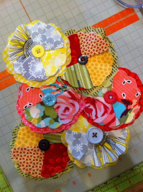 Fabric Flowers TUTORIAL HERE: http://blairpeter.typepad.com/weblog/2006/03/fabric_flowers.html