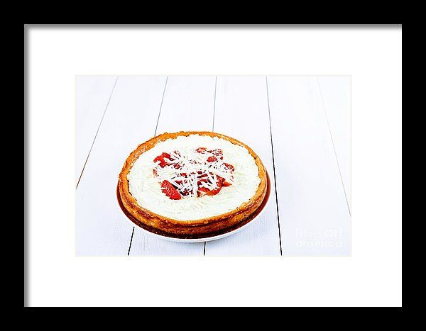 Homemade Strawberry Cheesecake On White Table Framed Print