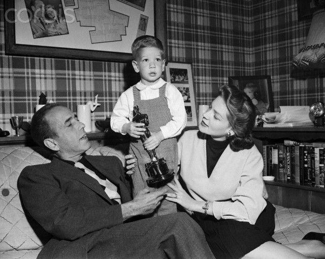 Humphrey Bogart, Lauren Bacall, and Son Stephen Bogart Holding Oscar Trophy