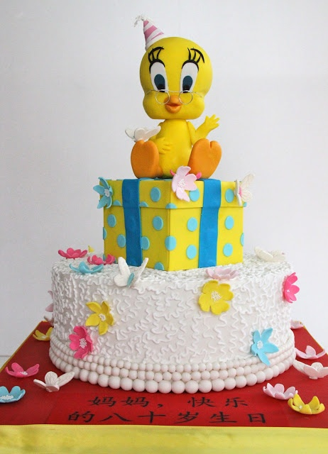 Kaelynn's 2nd Birthday - Maybe have the Bird Sitting on Top of a Present Celebrate with Cake!: Tweety Bird Cake