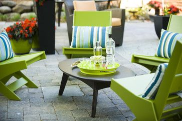 An outdoor dining area is the perfect place to experiment with color, either in the furniture or in your serving ware.