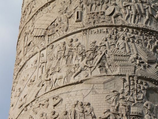 Trajan's Column was dedicated to the emperor in May 113 AD. It depicts the 1st and 2nd Dacian Wars (101-2 AD, 105-6 AD), but there are only 18 battle scenes, with the majority showing the daily activities of the army. There are 2500 figures, at least 60 of which are of Trajan himself, and the scenes are carved in low relief. Whilst scholars such as Lepper and Frere argue that the column is parallel to Trajan's account of the wars in his Dacica (just one line of the book survives), Settis…