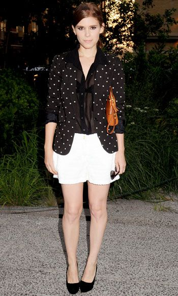 Kate Mara manages the perfect balance between pretty and cool. For a Coach summer kickoff party, she layered a polka dot Madewell blazer over Zara shorts and accessorized with a Coach clutch and Prada slingbacks.