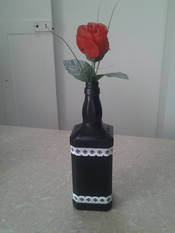 My awsome Jack Daniels vase.....spray paint it black add some white ribbon and a single red rose xxx