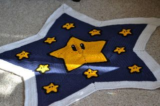 crochet Mario star blanket with free pattern link.
