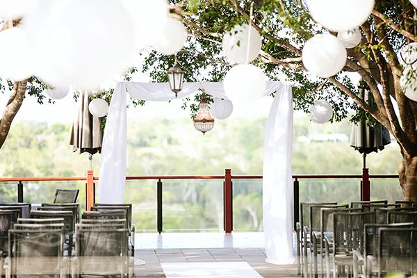 wedding ceremony arch with hanging chinese lanterns