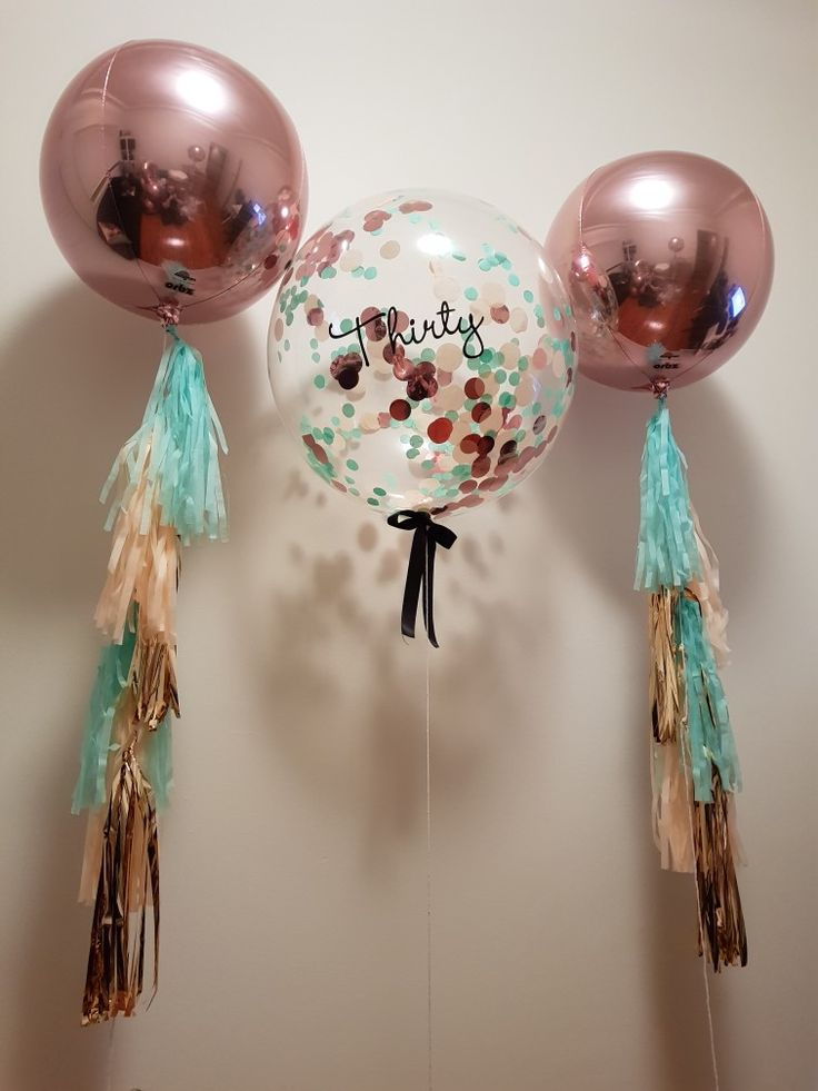 Rose gold orbz and confetti filled bubble with custom lettering, tassels & bow. Rose gold, peach and mint theme.  www.thepartyshere.com.au