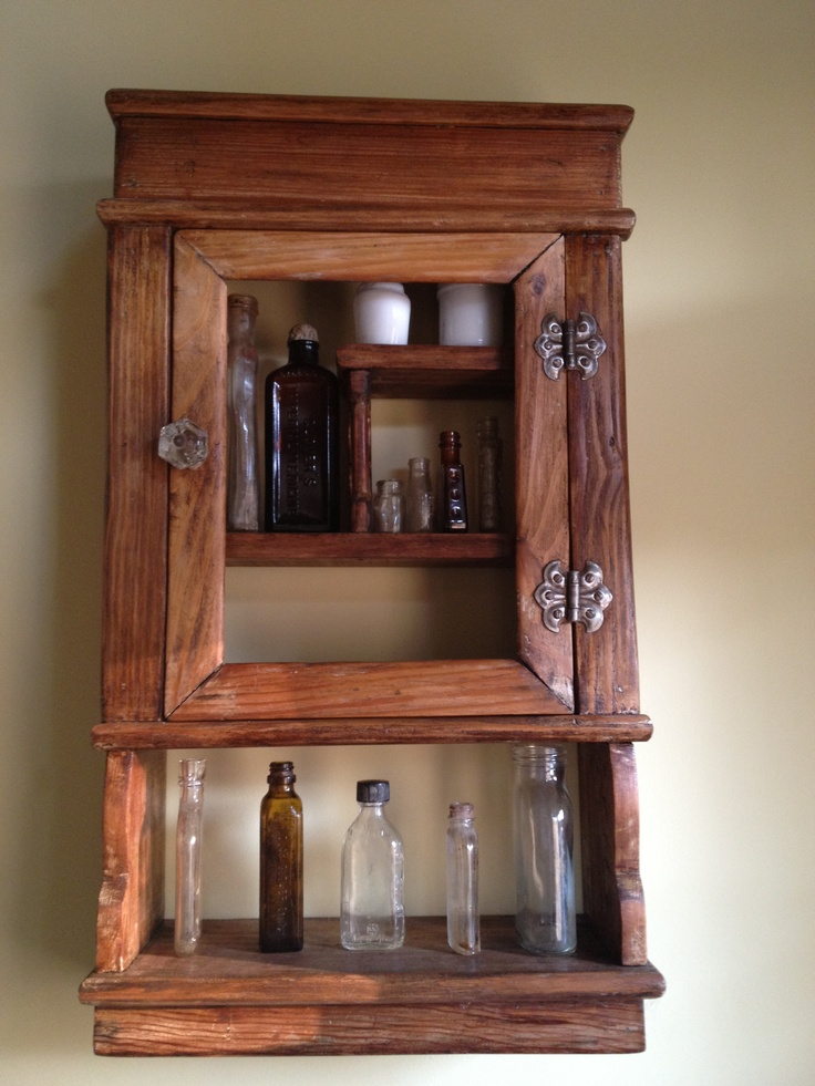 Antique medicine cabinet with our collected drug bottles