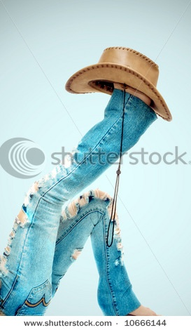 Feet wearing cowgirl hat