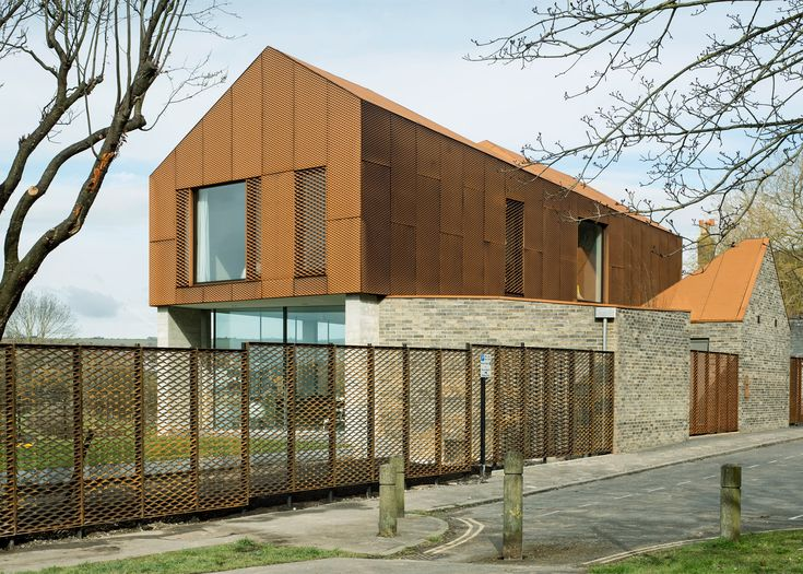 This riverside house in southeast England was designed by Sandy Rendel Architects with an upper storey clad entirely in weathering steel mesh
