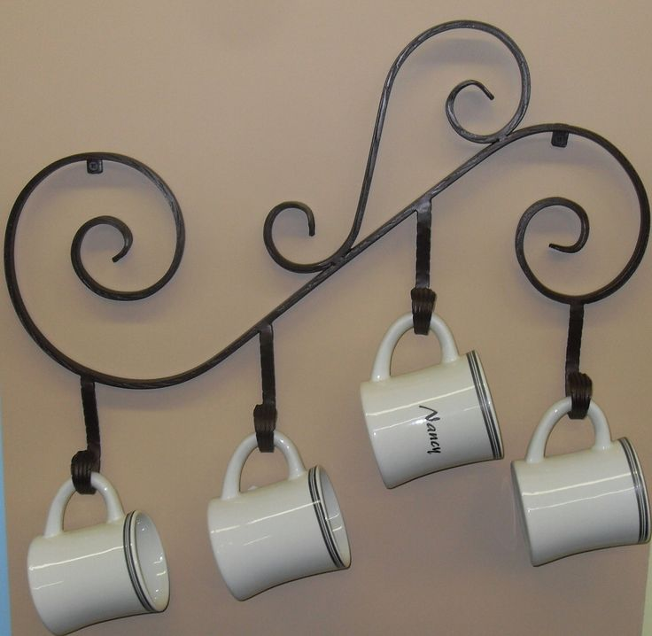 Coffee Mug Holder, Wall Mounted made out of Wrought Iron. $34.75, via Etsy.