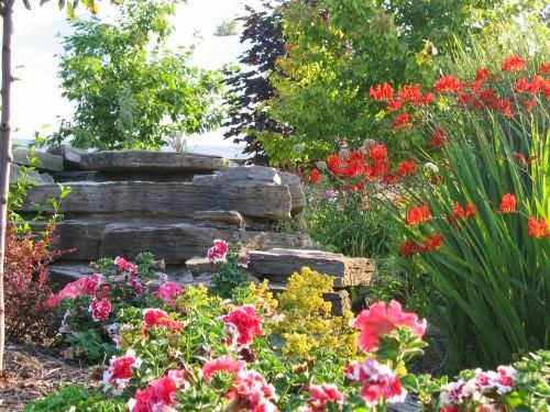 Beautiful flower garden with fountains and stonework...great place for picnicking, swimming and many other qualities.