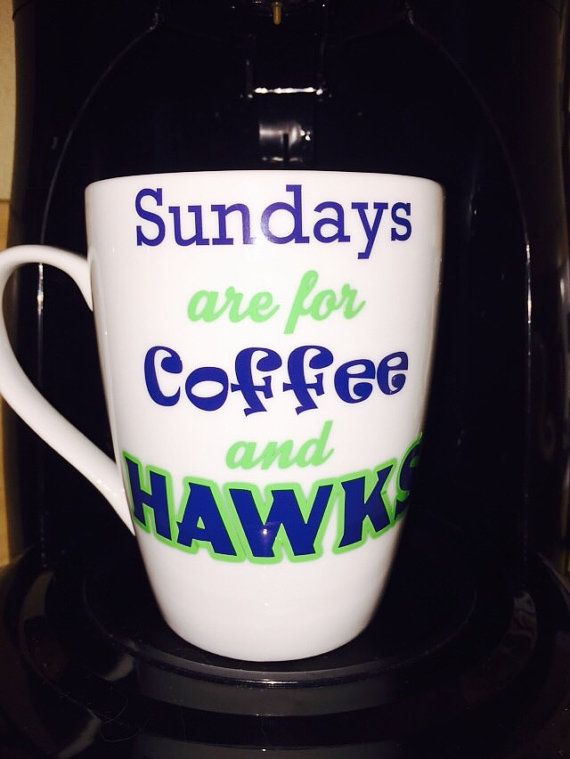 Sundays are for Coffee and HAWKS Seattle Football Custom Coffee Cup with vinyl detailing in blue and lime green. The is a durable coffee cup from Crate and Barrel, it is a generous 14 ounces, 4.5h porcelain white coffee cup . Add personalization with a 12 and name. please see photo 4 Images measure approx. 3 x 3 depending on the style of the cup. The vinyl used is a high quality performance vinyl.  Hand Wash Only Item. Please convo me if you need a different size or custom order! All our…