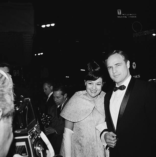 EVGENIA GL American actor Marlon Brando with his wife actress Movita Castaneda at the premiere of Brando's film 'The Mutiny on the Bounty' USA November 1962