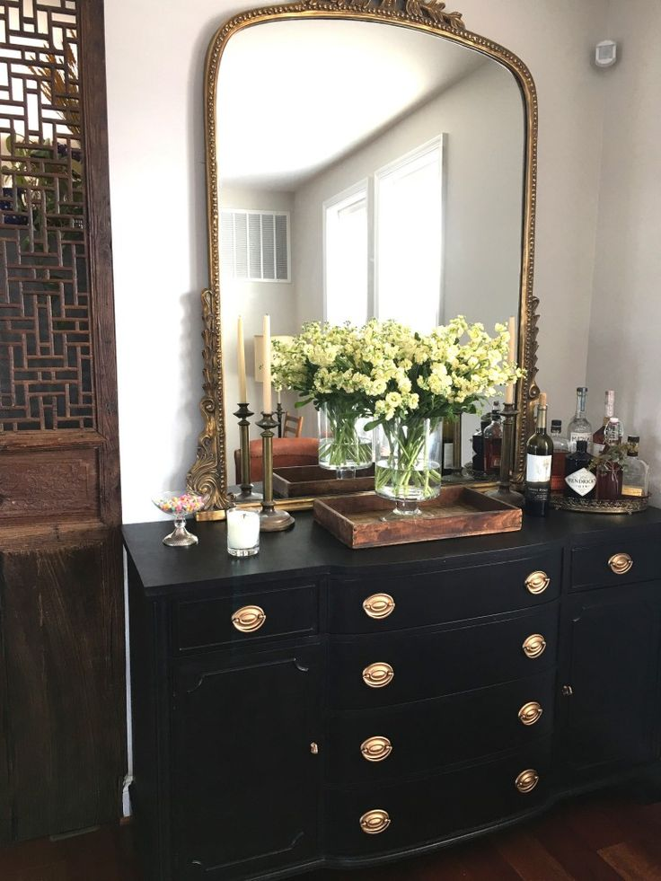 Love this gold mirror and styling for this room.