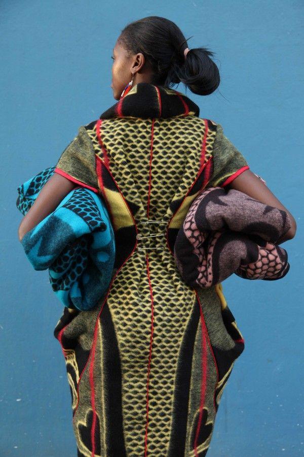photo: Niel Vosloo, Model Sibu Jili, Dress by Thabo Makhetha,Blankets available from Shnu Tribal & Basotho Blankets