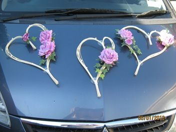 Wedding Car Decorations. They suction on to the front of the car. Cute!!