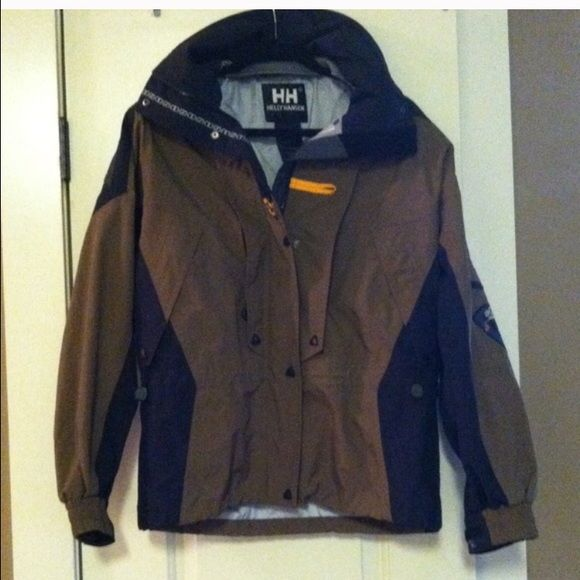 Helly Hansen black and brown coat Helly Hansen black and brown jacket.  Waterproof, wind proof, and has many cool pockets to put stuff.  Perfect condition with special insulation and aqua guard Helly Hansen Jackets & Coats