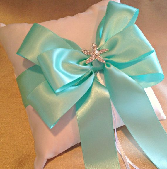 Starfish Ring Bearer Pillow with a Aqua double faced satin bow by A Priceless Princess  A rhinestone starfish has been added to the top of this hand-tied bow.  To see additional pictures and receive a special discount (PIN10) please visit my site.