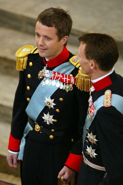Danish Crown Prince Frederik stands next to his brother Prince Joachim as he watches his bride Miss Mary Elizabeth Donaldson walk up the isle of Copenhagen Cathedral during their wedding ceremony on May 14, 2004 in Copenhagen, Denmark.