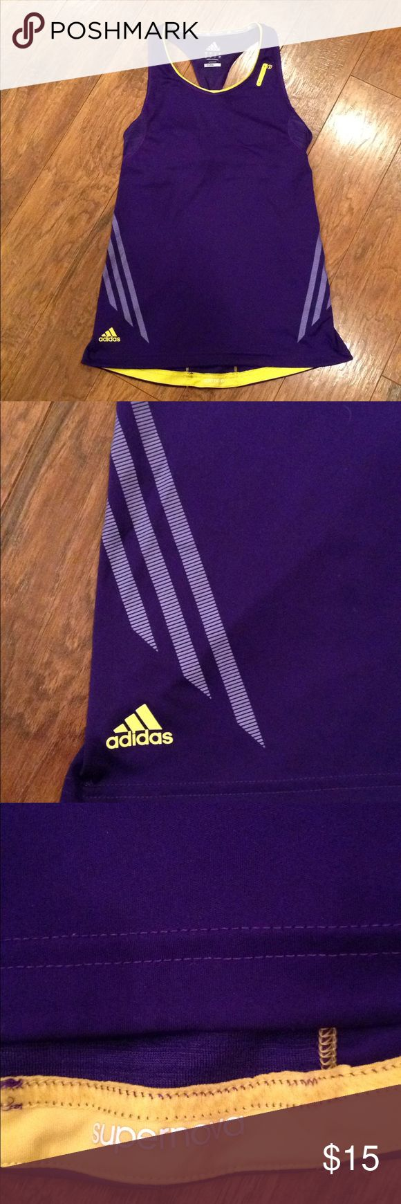 Adidas Supernova Support Tank Purple & Yellow S •Women's Adidas Supernova Support Tank Size Small.  In Excellent Condition.                                            •Colors: Vivid Purple and Vivid Yellow.        •This Adidas Supernova Support Tank top is built with ventilation channels that cool you off while you run, pulling cool air in and drawing heat and sweat away. The running tank top includes a handy media pocket on the strap and reflective details. adidas Tops Tank Tops