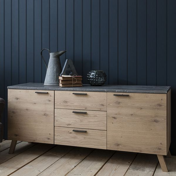 This stunning sideboard exudes a reassuring solidity and will make a strong presence in your living space.  Made of solid French Oak offset with a concrete resin top and hand cast bronze handles and featuring soft close drawer runners and hinges.