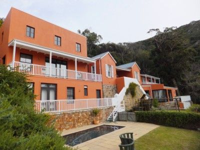 Down a charming quaint road in the historical sector of Simon's Town lies this unique stately residence. The lush magical surrounds of Redhill with its trees, river and beautiful views contribute to this home's enchanting setting.