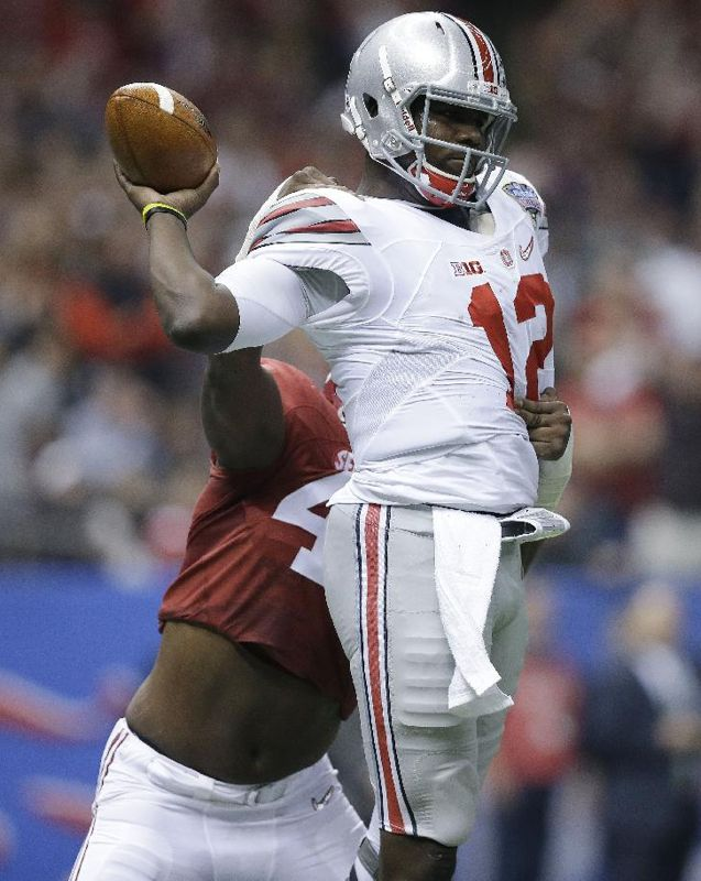 Alabama linebacker Xzavier Dickson (47) pressures Ohio State quarterback Cardale Jones (12) in the first half of the Sugar Bowl NCAA college football playoff semifinal game, Thursday, Jan. 1, 2015, in New Orleans