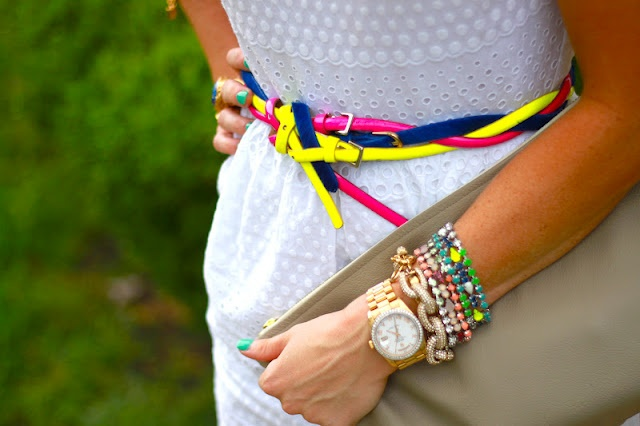 white eyelet dress and neon skinny belts