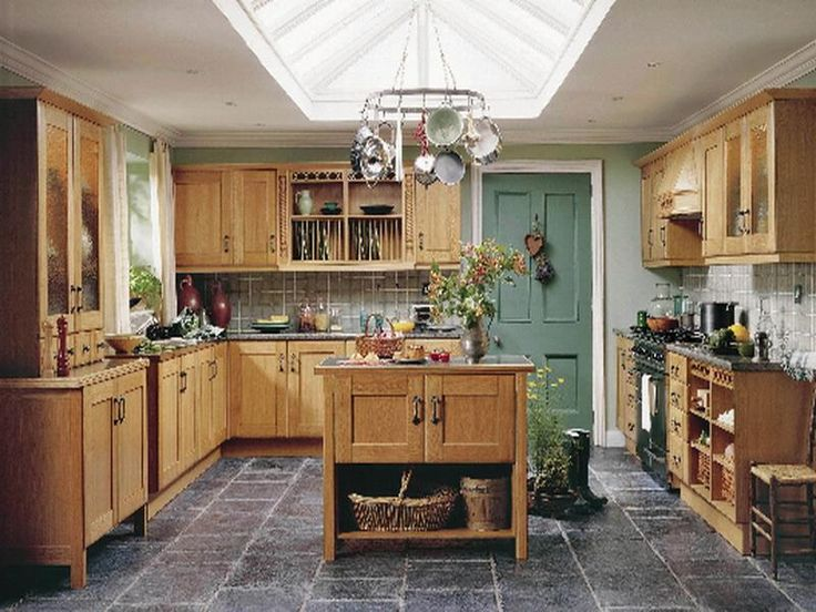 small country kitchen with wood cabinets and skylight over hanging pot rack