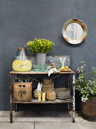 Use a potting bench as the perfect stand-in for a sideboard at a backyard bash.