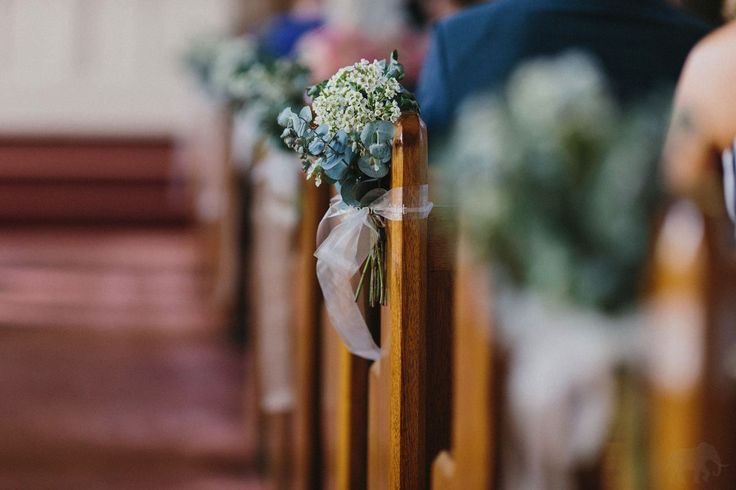 Native flower pew ends, blue gum and wax flower, organza bows. Simple, rustic, country, scented addition to the church, double them up to create a throwaway