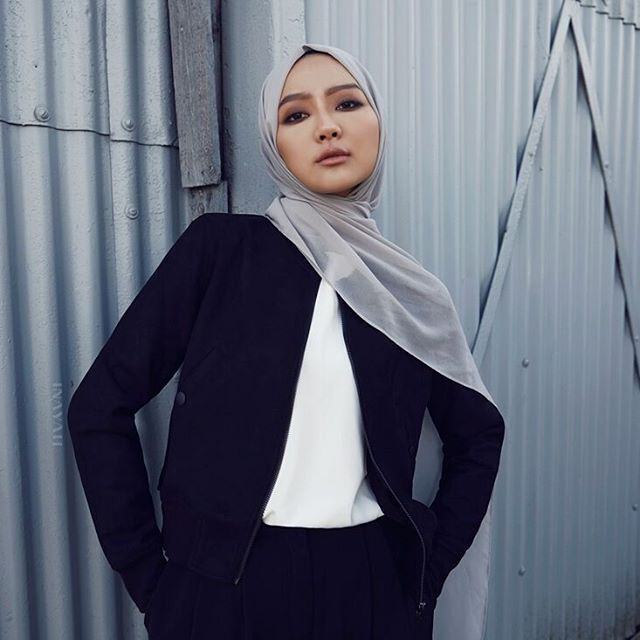 INAYAH | A limited edition, fitted and cropped black suedette bomber jacket. A faultless option for your layering needs.  Black Suede Bomber Jacket  White Classic Top  Mid Grey Soft Crepe Hijab  www.inayah.co