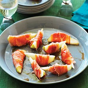 Prosciutto-Wrapped Pears: 2 pears, each cut into 8 wedges and cored   8 thin slices (4 oz.) prosciutto, cut in half lengthwise, 2 T evoo,   2 t sherry (or white wine) vinegar, Pinch of salt.  Wrap pear wedges with prosciutto and set on a serving plate. Drizzle with oil and vinegar, sprinkle with salt.