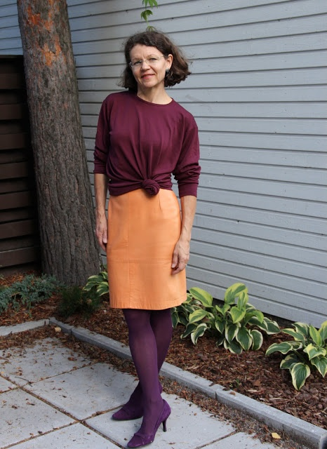 orange leatherskirt burgungy pullover purple pumps