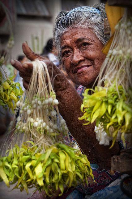 Quiapo Church, Manila - Flower seller by Mio Cade.
