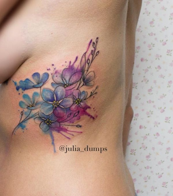Blue shaded cherry blossom tattoo. It's not often that you see other shades on the cherry blossoms but this design by Julia Dumps makes it look magical and interesting at the same time.