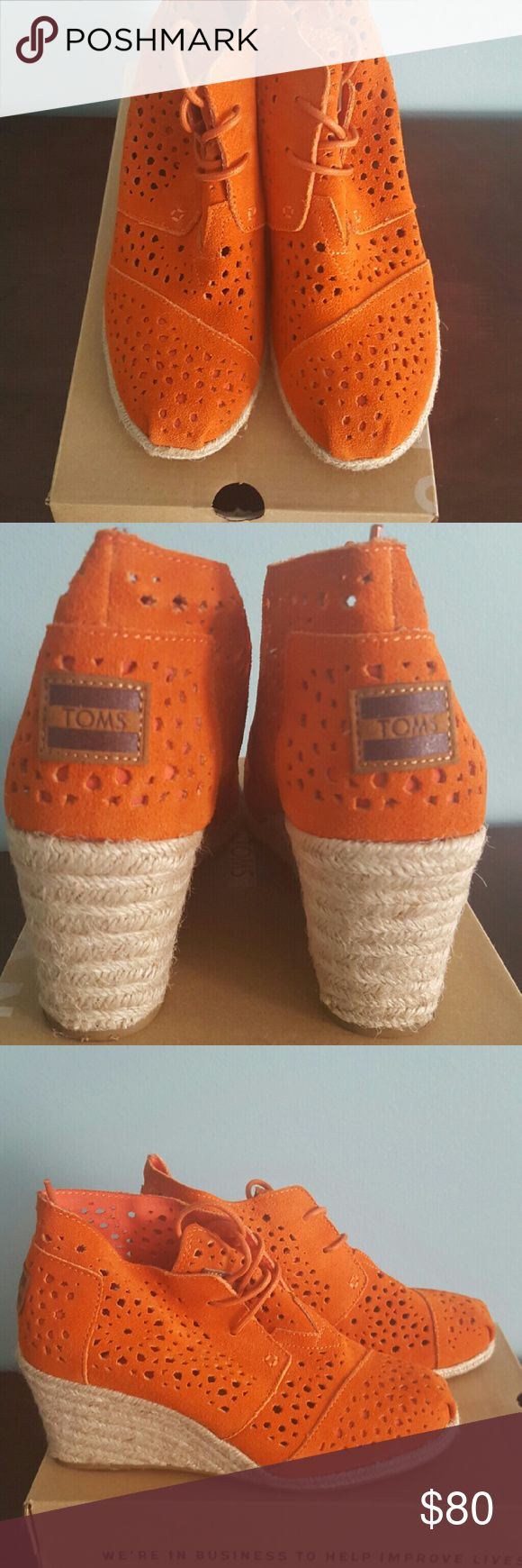 "TOMS Moroccan Cutout Suede Wedge Boot, Orange Perforated suede upper w/tonal topstitching. Ankle-high shaft; 2 3/4""H; 11"" circumference. 2 3/4"" braided jute wedge heel. Lace up vamp. Logo applique on tongue & heel counter. Rubber & jute sole provides traction. TOMS Shoes Ankle Boots & Booties"
