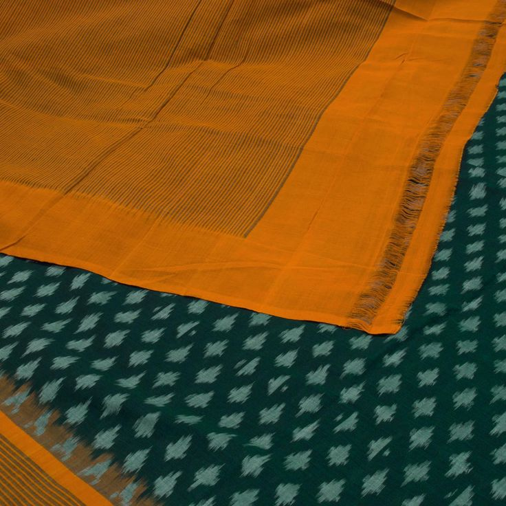"""The """"Green"""" #handwoven Ikat Cotton Sari from Parisera is woven in greenish blue bhutas in ikat that is set off by a mustard stripes border and pallu that add beauty to the sari. The mustard blouse completes the sari."""