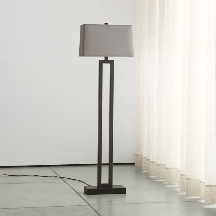 Shop Duncan Antiqued Bronze Floor Lamp with Grey Shade.  A smoky grey shade adds moody ambiance to Duncan, our chic, unique floor lamp.