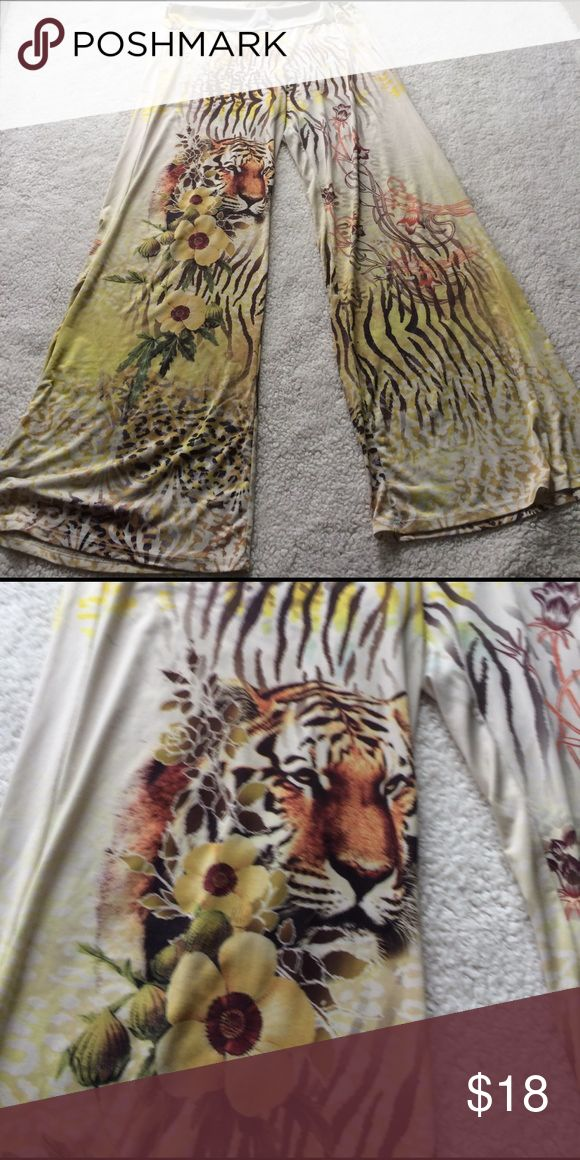 "Jungle theme wide leg spandex pant Fun wide leg spandex pants with a great jungle theme! Used condition. Elastic waistband. Same pattern on the back of pant!  Measurements laying flat:  💜16"" waist  💜13"" rise 💜33"" inseam   🌸🎀 I offer a 20% off bundle discount! Feel free to shop around my closet! Enjoy! 🎀🌸 Pants"